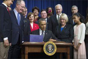 essa-obama-signs-blog-thumb-500x333-16391